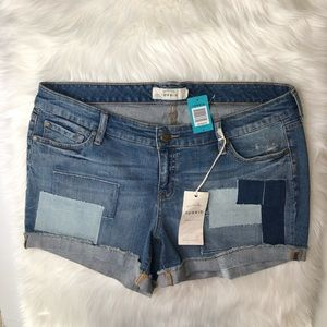 NWT TORRID. Denim patchwork shorts w/ cuffed hem.